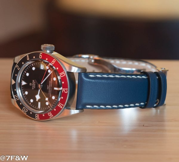 Padded blue clasp watch strap