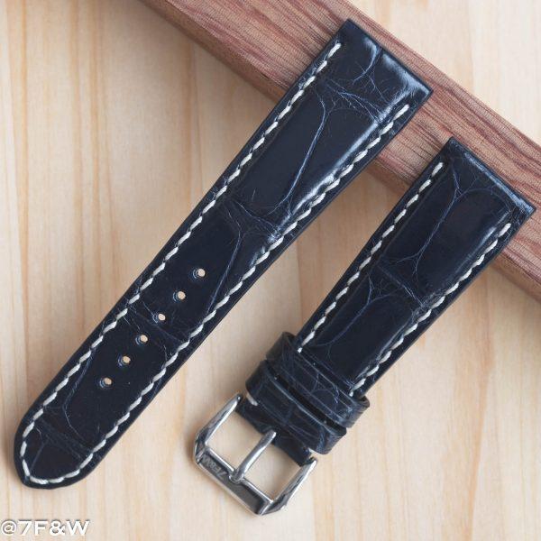deep blue alligator watch strap with white stitching